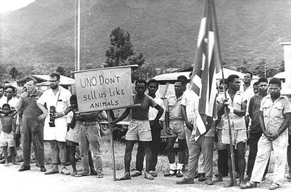 West Papuans holding placards, calling for UN assitance, after Indonesia's invasion of West Papua in 1962